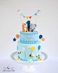 cute 1st birthday cake for little eyad underneath was a light a