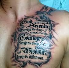 torn skin serenity prayer chest tattoos