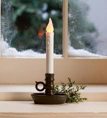 we window candles in all our windows during the holidays got