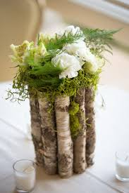 wood log vases wood moss carnation centerpieces i can hear the bells