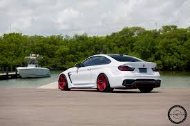 teal car white rims alpine white widebody bmw m4 looks great on red wheels my car portal