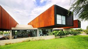 cheng franco cantilever trio of corten steel clad volumes from