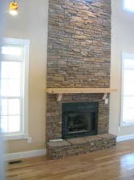 electric fireplace mantel multicolor stone facade wall maple