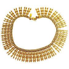 bib necklace metal images Vintage monet gold plated egyptian bib necklace sold ruby lane jpg