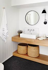 inside a surprisingly warm black and white abode wood bathroom