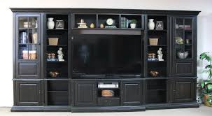 the aston range tall distressed effect wooden bookcase with
