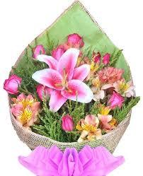 pink lillies 12 pink roses pink peruvian lilies stargazer bouquet flower