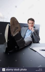 Legs On Desk Portrait Of Young Entrepreneur Sitting With His Feet On Desk Stock