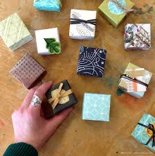 learn to make tiny gift boxes out of last year s greeting cards