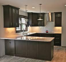 kitchen cabinets with light granite countertops herringbone backsplash kitchen callier and thompson