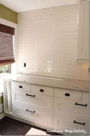Kitchen Cabinets With Knobs Small Subway Tile In Kitchen Traditional With Black Cabinet
