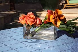 Rectangle Vase Centerpiece Encore Centerpieces Copper Colored Flowers In Glass Rectangle