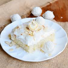 raffaello poke cake coconut cake with white chocolate coconut