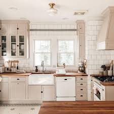 how to paint cabinets with farrow and 8 great neutral cabinet colors for kitchens the grit and
