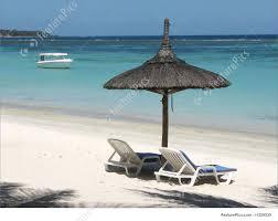 Chairs On A Beach Island Umbrella Stock Image I1229530 At Featurepics