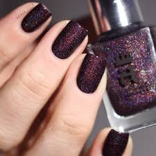 a england in robe and crown dark purple glitter nail polish