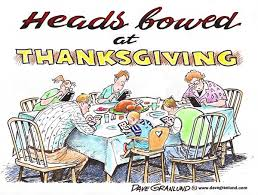 heads bowed at thanksgiving the