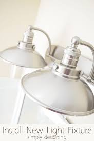 how to install a light fixture install a new bathroom light fixture