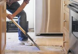 should you install flooring before you install cabinets