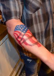 dark american flag tattoo on forearm photos pictures and