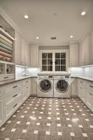 Pinterest Laundry Room Cabinets - painted cabinets starburst floor brass details laundry room