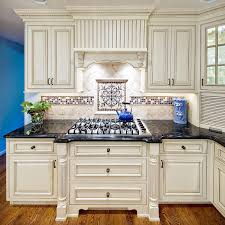 white brick backsplash blue kitchen cream accents blue and cream