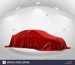 new car gift bow presentation of new car with question wrapped a sheet