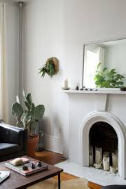 white fireplace with plants and a mirror botanicals pinterest white fireplace with plants and a mirror candles in