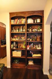 this guys secret bookshelf is something everyone needs