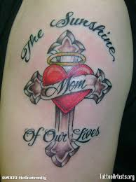 memorial cross and heart tattoo on biceps in 2017 real photo