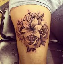 black and grey lily flower with roses tattoo design for upper arm