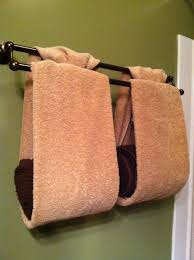 bathroom towel folding ideas store and decorate with towels fold towels in thirds tie ends