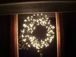 lighted christmas wreath reused items to make lighted christmas window wreath