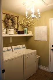 beautiful two white laundry room below candle chandelier with