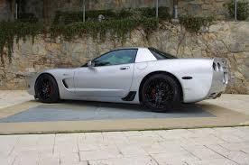 c5 corvette black forgestar f14 1 pc cast wheels in piano black for c5 and c6 corvettes