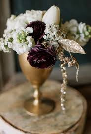 wedding flowers sheffield purple white and gold flower arrangement photo by