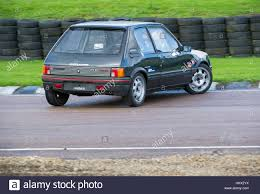 peugeot 205 gti peugeot 205 gti on a track day lydden hill race track stock photo