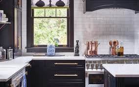 white kitchen cabinets with gold pulls for your home don t be afraid to mix metals in the kitchen