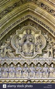 detail of stone carvings of jesus angels and disciples on