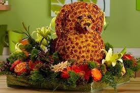 dog flower arrangement poodle sculpture made of flowers