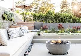 sunken concrete patio with concrete bowl fire pit transitional