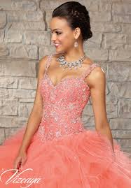embroidered and beaded bodice on a ruffled tulle skirt quinceanera