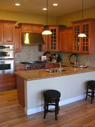 Staggered Cabinets Pictures Of Kitchens Traditional Medium Wood Golden Brown