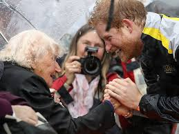 Prince Harry by Prince Harry Reunites With 97 Year Old Fan In The Pouring Rain