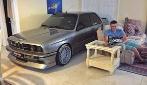 bmw in bmw owner goes viral after parking car in living room to protect