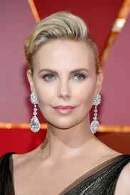 mismatched earrings trend are matching earrings uncool three jewelry designers weigh in