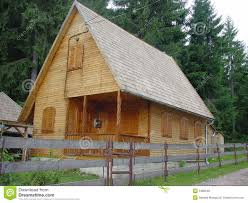 wood house with log walls and shigle roof royalty free stock
