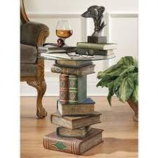 power of books sculptural glass topped side table power of books glass top side table a long awaited treachery