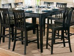 dining room with black counter height table and chairs benefits
