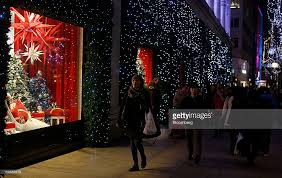 Christmas Decorations Oxford Street - christmas lights lure shoppers in search of bargains photos and